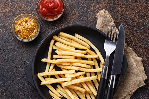 French fries with tomato sauce and mustard