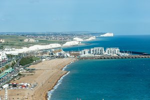 Aerial view of sunny summer Brighton, coastline, Seven Sisters on the horizon
