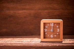 wood clock on wooden table