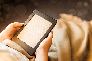 Girl is reading ebook on digital tablet device