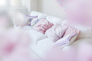 Lilac pillows on white couch