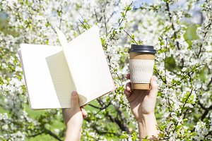 Diary and a cup of coffee. Spring