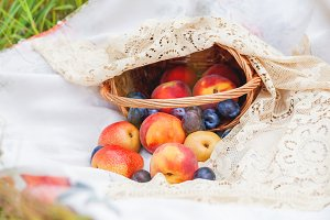 Basket with fruits, outdoor picnic