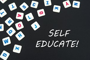 english colored square letters scattered on black background with text self educate