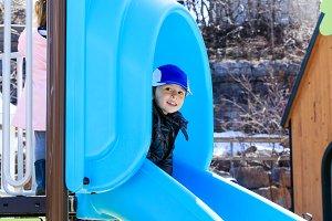 Cute boy plays on playground