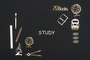 School supplies placed on black background with text study