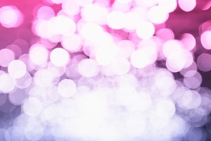 Pink and purple light reflection on water bokeh background