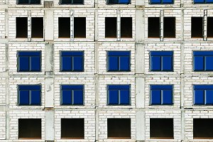 Symmetric windows at construction site background