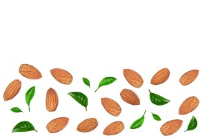 almonds decorated with leaves isolated on white background with copy space for your text. Top view. Flat lay pattern