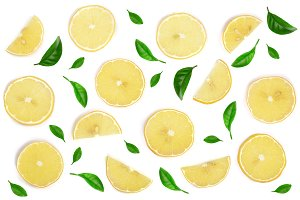 Slices lemon decorated with green leaves isolated on white background. Flat lay, top view