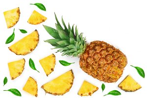 Sliced pineapple decorated with green leaves isolated on white background with copy space for your text Top view