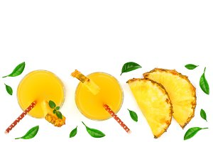 pineapple juice and pineapple slices with green leaves isolated on white background with copy space for your text