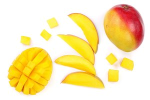 Mango fruit and slices isolated on white background close-up. Top view. Flat lay