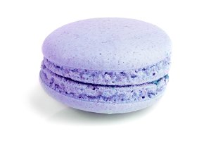 purple macaron isolated on white background closeup
