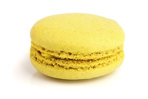 yellow macaron isolated on white background closeup