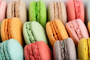 colorful macarons as a background closeup macro