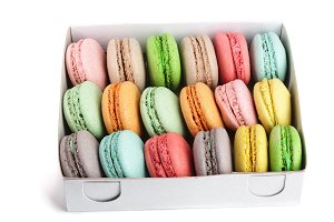 colorful macarons in box isolated on white background closeup