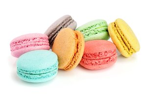colorful macarons isolated on white background closeup
