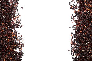 Black quinoa seeds isolated on white background with copy space for your text. Top view