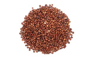 red quinoa seeds isolated on white background. Top view
