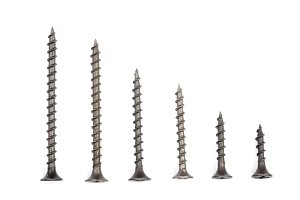 black screws isolated on white background closeup. Top view.