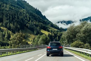 Scenic view of road crossing Alps mountains