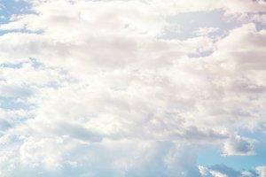Sunny blue sky background with brush