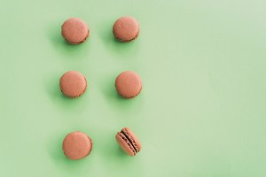 Flat lay of macarons on green background