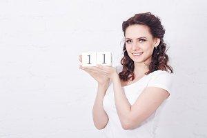 Girl holding number eleven.