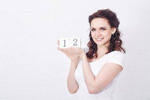 Girl holding number Twelve.