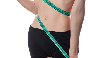 Girl measures the waist. Weight loss