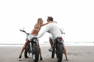 Young beautiful couple on motorcycle
