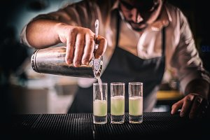 Bartender pouring fresh cocktail
