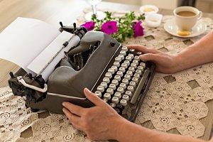 Female holding retro typewriter