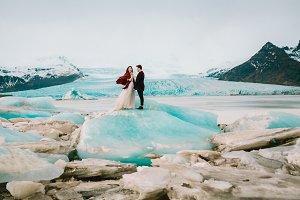Iceland Ice Beach Or Jokulsarlon Iceberg Beach - Bride and Groom is standing on Iceberg