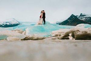 Iceland Ice Beach Or Jokulsarlon Iceberg Beach - Newlyweds is standing on Iceberg