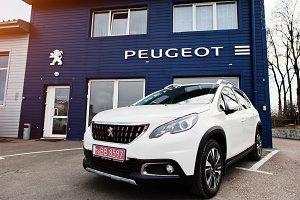 New Peugeot car at dealership.