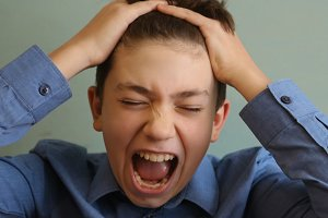 teenager boy have ahdh anger fit nervous breakdown close up photo