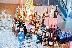 Alcohol bottles on wedding banquet