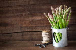Bundle of fresh asparagus copy space
