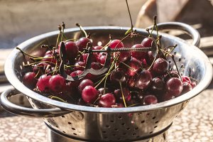 Fresh ripe cherry in colander
