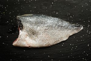 fillet of  raw bream fish with salt