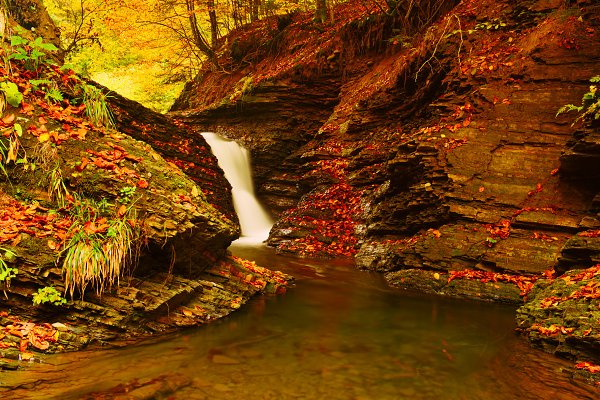 Autumn mountain waterfall