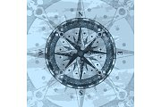 Grunge blue background with compass rose