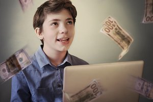 talented successful ambitious teenager boy with laptop freelance
