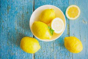 Yellow lemons with mint leaves