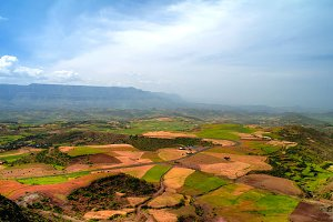 Aerial Panorama of Semien mountains and valley with fields of teff around Lalibela in Ethiopia