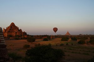 Dhammayangyi temple at sunset with the balloons, Bagan, Myanmar