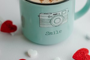 Valentine's day concept coffee cup with red heart.