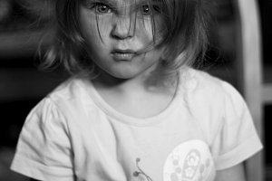 Close-up portrait of an angry child.